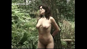 slave tied to a tree www xnxxm is hit with a whip and master mastrubates her pussy while her husband is watch