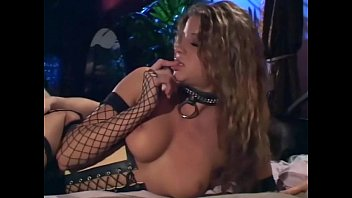 sex in yuporn a corset black boots and fishnet stockings