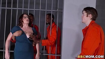 busty mom maggie green takes two bbcs in pornol a jail