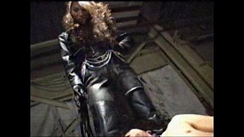 asian femdom tits pop out full leather pants and jacket trampling ball kicking with long fetish boots